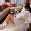 Stock Photo: Pregnant woman resting on sofa