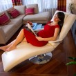 Pregnant woman resting on sofa — ストック写真