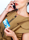 Woman with credit card and mobile phone — Fotografia Stock