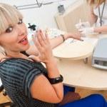 Woman in manicure salon — Stock Photo #26322181