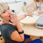 Woman in manicure salon — Stock Photo #26323531