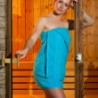 Attractive woman in sauna — Stockfoto