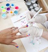 Painting nails — Stock Photo