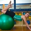 Woman in gym on pilates ball — Stock Photo