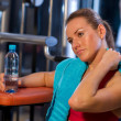 Tired woman in gym — Stock fotografie