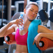 Woman in gym with water bottle — Stock Photo #26331973