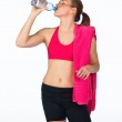 Woman drinks from water bottle — Stock Photo #26335655