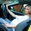 Pregnant woman driving — Stock Photo