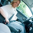 Pregnant woman using safety belt — Stock Photo