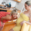 Pregnant woman with her sister — Stock Photo #26339631
