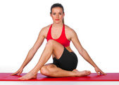 Young woman in yoga pose — Stock Photo