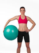 Strong woman with pilates ball — Stock Photo