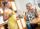 Pregnant woman with her sister — Stock Photo