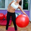 Stock Photo: Attractive womexercise with pilates ball