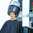 Woman using hair dryer — Foto de Stock
