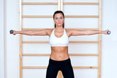 Woman workout with weights — Stock Photo