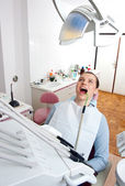 Woman in dentist chair — Stock Photo