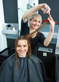 Hair stylist working on haircut — Stock Photo