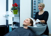 Woman drying hair in salon — Stock Photo