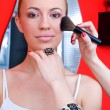 Woman putting on make up — Stock Photo