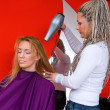 Stylist with hair blower — Stockfoto