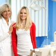 Woman dentist with female patient — Stock Photo