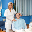Royalty-Free Stock Photo: Woman dentist with male patient