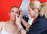 Make up stylist at work — Stock Photo