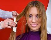Hair stylist making haircut — Stock Photo
