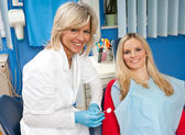 Woman dentist with patient — Stock Photo