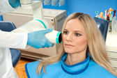 Patient taking dental x-ray — Stock Photo