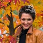 Woman in autumn scenery — Stock Photo #26371039