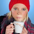 Woman with tea cup — Stockfoto