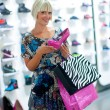 Woman shopping shoes — Stock Photo