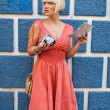 Woman with camera on the street — Stock Photo #26580051