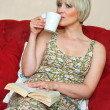 Woman drinking coffee — Stock Photo #26580171