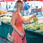 Woman on market place — Stock Photo #26580927