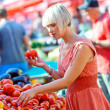 Woman on market place with vegetables — Foto Stock