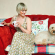 Woman and dog on sofa — Stock Photo