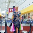 Woman in shopping mall — Stock Photo #26582059