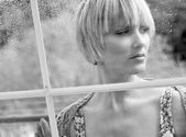 Sad woman at the window — Stock Photo