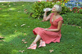 Woman drinks water — Stock Photo