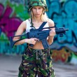 Army girl with rifle — Stock Photo #27435561