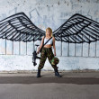 Army girl with rifle with angel wings — Stock Photo #27435583