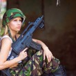Army girl with rifle — Stock Photo #27435717