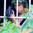 Army girl with rifle — Stock Photo #27436783