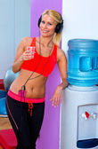 Woman with water in gym — Stock Photo