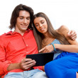 Young couple with tablet — Stock Photo #28228337