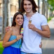 Young couple with ice creams — Stok fotoğraf