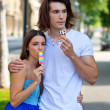 Young couple with ice creams — Stock Photo